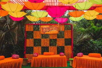 Colorful mehendi decor with umbrellas