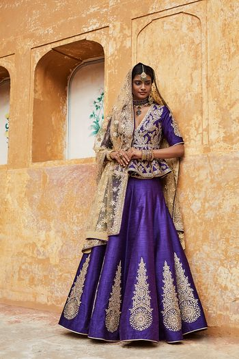 Photo of Purple Bridal Lehenga with Silver Motifs