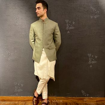 Olive green jacket with kurta pyjama for grooms.