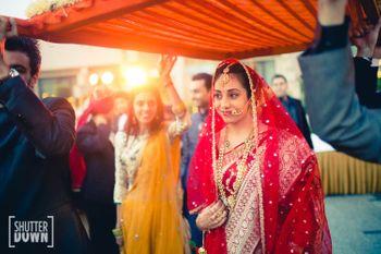 Bride in Red Benarasi Saree Entering