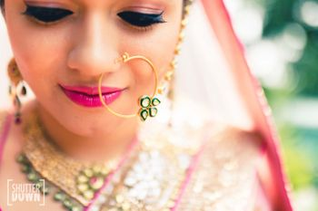 Photo of Pink bridal makeup with nosering