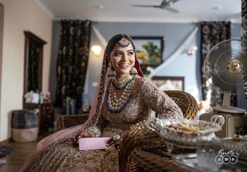 Candid shot of a bride smiling on her wedding day.