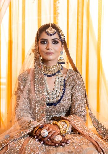 Candid shot of a bride dressed in a heavy lehenga.