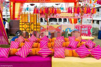 Colourful sitting arrangement for Mehendi ceremony