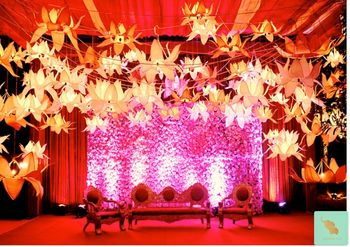 stage decor with floral wall and hanging metal lotus