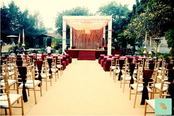 Outdoor mandap with red drapes