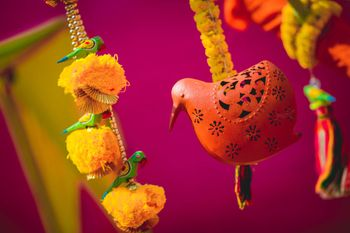 Terracotta Birds with Genda Phool Strings