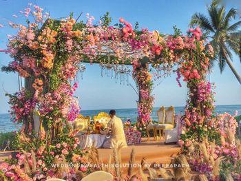 Pretty floral mandap by the sea