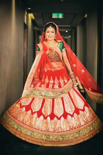 Bride in Red Lehenga with Green Border and Blouse