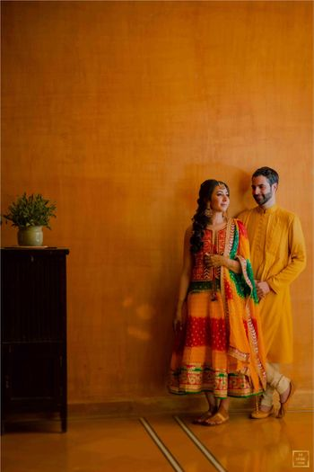 Photo of A candid shot of a couple dressed in vibrant outfits.