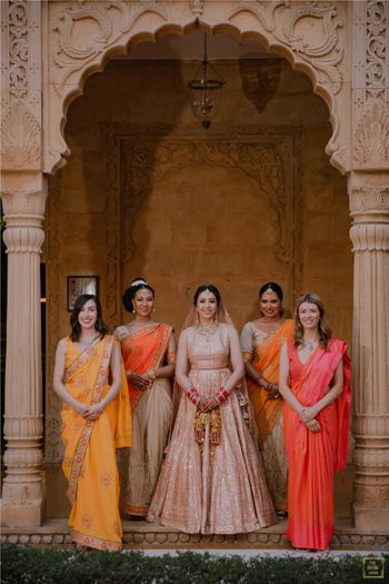 Photo of Bride posing with her squad.