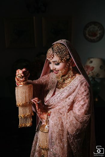 Beautiful bride in OTT jewellery.