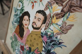 decor with bride and groom caricature for mehendi