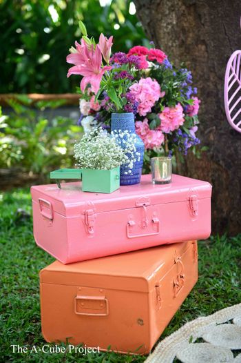 Hand-painted trunks with floral arrangements.