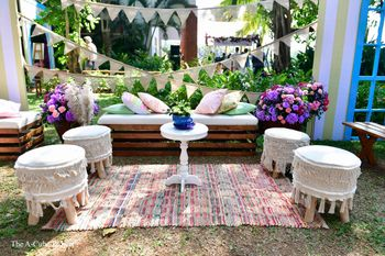 Outdoor decor with carpets, cushions, flowers, and more.
