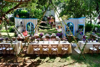 Outdoor table settings with teepee tents.