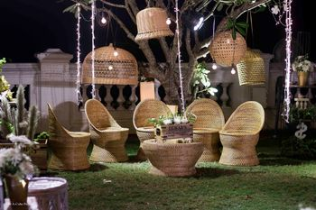 Photo of Upturned baskets and cane chairs for outdoor decor.