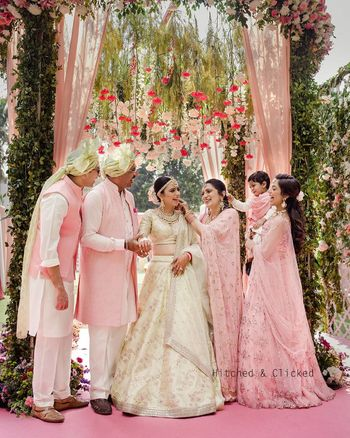 Photo of Candid shot between bride and her family