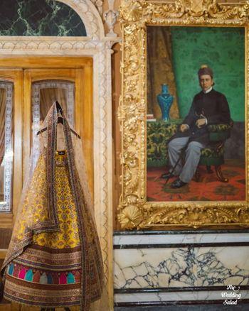 Photo of mustard yellow bridal lehenga on hanger