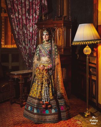 multicolour sabyasachi bridal lehenga with unique kaleere