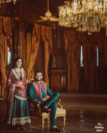 Photo of matching mehendi bride and groom outfits in dark green and red