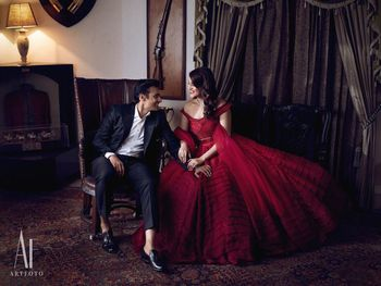 Photo of Couple on cocktail with the bride in a red gown