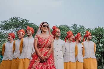 Photo of bride with brothers