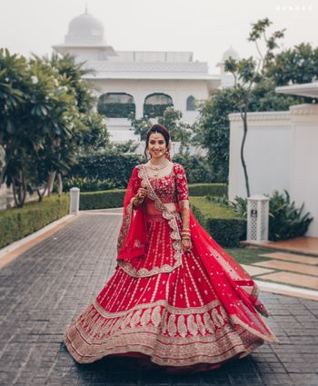 Twirling red lehenga shot