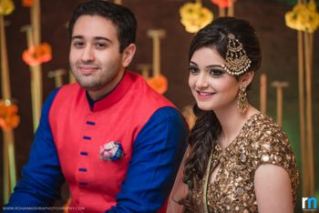 Bride with Dull Gold Outfit and Jhoomer on Engagement