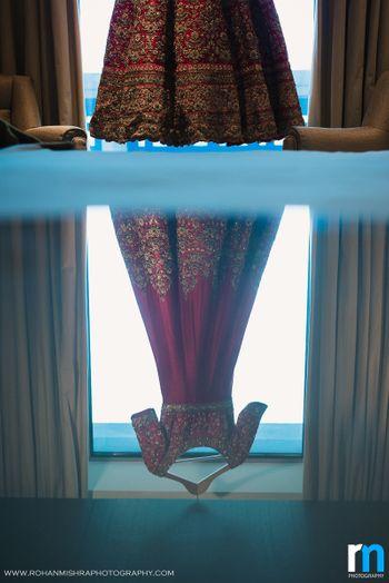 Reflection of Maroon Bridal Anarkali on Hanger