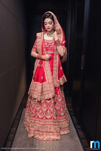 Muslim Bride in Red Anarkali with Gold Zardozi Work