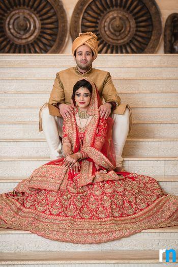 Muslim Bride in Red and Gold Zardozi Work Lehenga