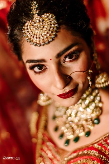bridal makeup with red lehenga with deep red lips