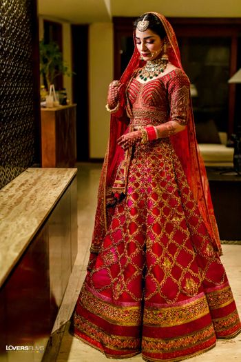 red modern bridal lehenga with gold work