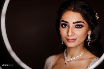 bridal makeup for cocktail with bold brows and smokey eye