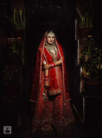 bright red bridal lehenga with sequin work