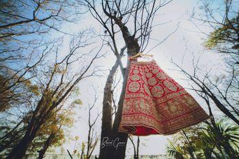 Red Lehenga on Hanger on Tree Branch