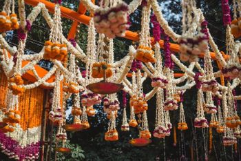 Photo of pretty orange and white mogra hanging decor for entrance