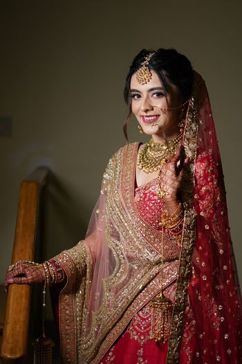 Bride wearing a red lehenga on the wedding day.