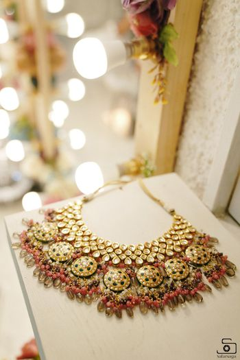 bridal necklace photography with pink beads