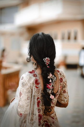 Messy floral braid hairstyle.