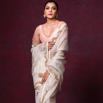Ivory saree with a pink blouse.