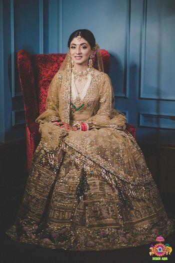 unique offbeat bridal lehenga in gold