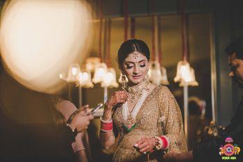 bridal portrait in gold lehenga with rani haar