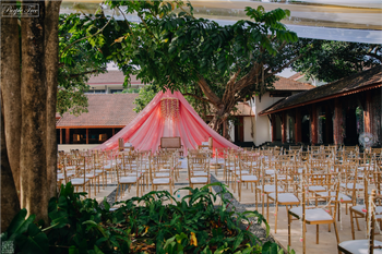 Tent style mandap under the tree.