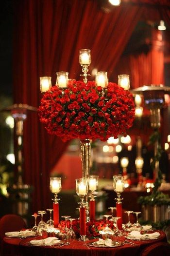 Photo of table centerpieces with roses and candles