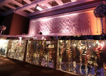 Photo of bar decor with see through glass and florals inside the glass