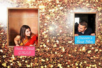 Photo of glitter cutout photobooth with wall