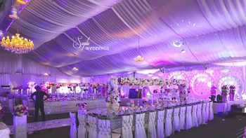 Photo of white themed engagement with draped ceiling