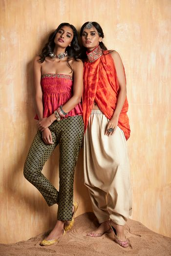 Photo of Orange tie dye dhoti with draped outfit